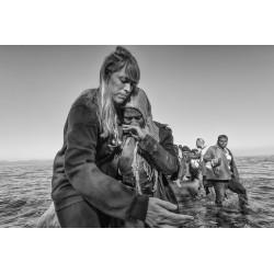 Margarita Mavromichalis - Relief volunteers help each...