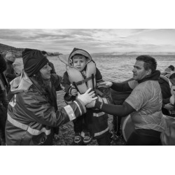 Margarita Mavromichalis - Young boy carried to safety by...