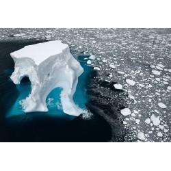 Daniel Beltra - An iceberg floats in sea ice of the Ross Sea - 2007
